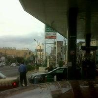 Photo taken at Pemex by Carlos V. on 6/16/2012