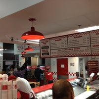 Photo taken at Five Guys by Tj W. on 12/29/2011