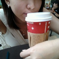 Photo taken at Starbucks by Ashley M. on 12/4/2011