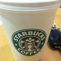 Photo taken at Starbucks by esam a. on 9/11/2011