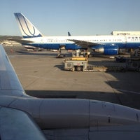 Photo taken at Gate 85 by Dano R. on 4/6/2012