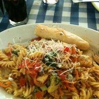 Photo taken at Italianni's Pasta, Pizza & Vino by Jatzii M. on 8/12/2012