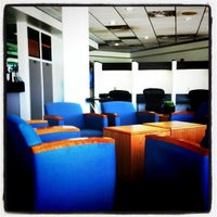 Photo taken at Delta Sky Club by J R. on 7/10/2011