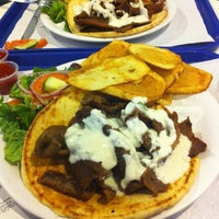 Photo taken at Zorba's Cafe by Amy J. on 7/20/2012