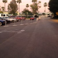 Photo taken at Katella Cast Member Parking Lot (K-Lot) by Christina A. on 12/30/2011