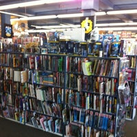 Photo taken at 8th Street Books & Comics by Jonathan T. on 8/21/2012