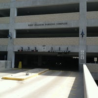 Photo taken at West Stadium Parking Complex by Joan A. on 9/12/2011