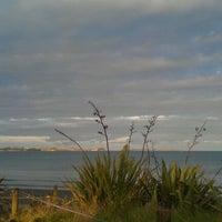 Photo taken at Long Bay Beach by Olga F. on 1/26/2012