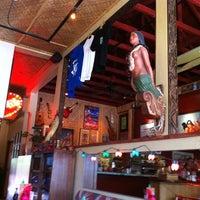 Photo taken at Hula's Island Grill & Tiki Room by Tonia E. on 7/1/2011