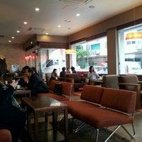 Photo taken at Starbucks by Juno P. on 10/21/2011