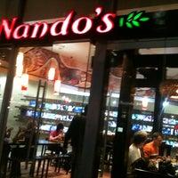 Photo taken at Nando's by Tai H. on 8/6/2011