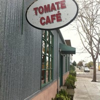 Photo taken at Tomate Cafe by Andrea M. on 1/2/2011