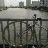 Photo taken at King Taksin Bridge by Nile on 7/18/2012
