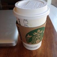 Photo taken at Starbucks by Erin M. on 4/7/2012