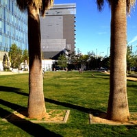 Photo taken at LAPD Lawn Dog Park by Emerson Q. on 4/4/2012