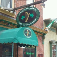 Photo taken at Molly Maguires Pub & Steakhouse by Bonnie S. on 3/10/2012