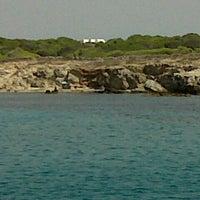 Photo taken at Cala Rotonda by Antonella A. on 7/28/2012