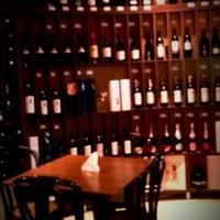 Photo taken at Carpe Diem Wine Shop & Bar by M A. on 4/19/2012