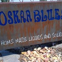 Photo taken at Oskar Blues Home Made Liquids & Solids by Chrissy E. on 7/5/2012