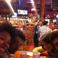 Photo taken at Hooters by Tiziano B. on 3/7/2012
