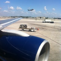Photo taken at Gate D8 by Carlos C. on 4/17/2012