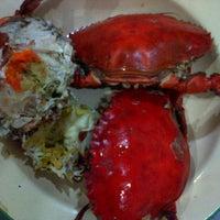 Photo taken at Seafood 212 Wiro Sableng by Ruby C. on 8/6/2012