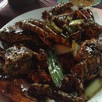 Photo taken at Batu Lintang Seafood by Kelyn on 8/17/2012