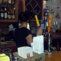 Photo taken at New Socials Bar & Grille by Dawn Z. on 4/24/2012