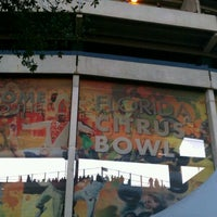 Photo taken at Camping World Stadium by Andrew T. on 12/29/2011