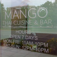 Photo taken at Mango Thai Cuisine & Bar by Juta B. on 6/11/2011