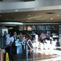 Photo taken at Starbucks by Seçkin Anıl Ü. on 8/18/2011
