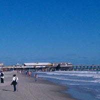 Photo taken at Cocoa Beach Pier by John Mateo 🇮🇹 on 11/12/2011