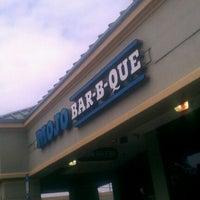 Photo taken at MOJO Bar B Que, A Southern Blues Kitchen by Chris J. on 9/9/2011