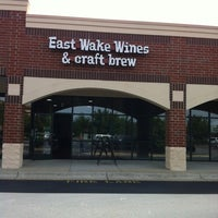 Photo taken at East Wake Wines & Craft Brew by Chrissy A. on 5/12/2012