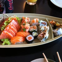 Photo taken at Oishii Sushi by Marcio I. on 12/10/2011