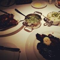 Photo taken at Delmonico Steakhouse by Tina W. on 6/9/2012