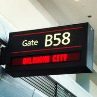 Photo taken at Gate B58 by Rafaela E. on 2/25/2012