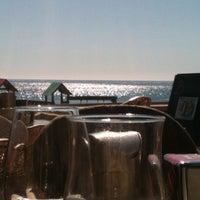 Photo taken at Playa Marina Beach by Sanne O. on 3/11/2012