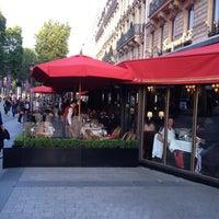 Photo taken at Le Fouquet's by Alex M. on 6/8/2012