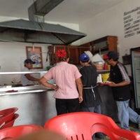 Photo taken at Taqueria Tres Hermanos by Felipe G. on 6/18/2012
