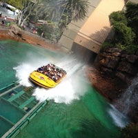 Photo taken at Jurassic Park: The Ride by Chris L. on 7/10/2012