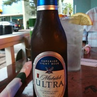 Photo taken at Mulligan's Beach House Bar & Grill by Mary N. on 6/13/2012