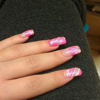 Photo taken at Fancy Nails & Spa by Nina F. on 3/8/2012