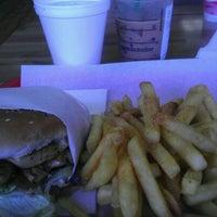 Photo taken at Apollo Burgers by Jesenia G. on 1/31/2012