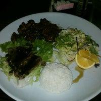 Photo taken at Fuji Wok & Sushi by Pina COLEada on 2/10/2012