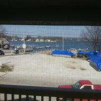 Photo taken at Curly's Waterfront Pub & Grill by Mark J. on 3/18/2012