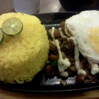 Photo taken at Sisig Sarap by liu m. on 4/28/2012