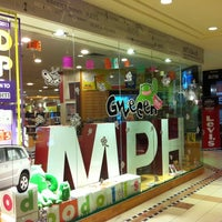 Photo taken at MPH Bookstore by Yoyo Y. on 9/17/2011