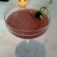 Photo taken at Flora Restaurant & Bar by Michael K. on 7/31/2011