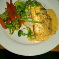 Photo taken at Suite 100 Restaurant, Bar & Lounge by Joe M. on 9/8/2011